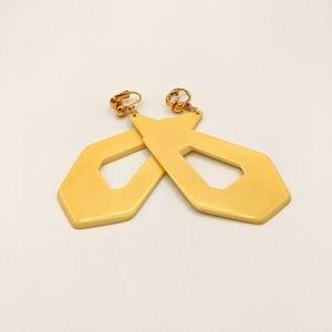 VTG Bakelite TESTED MCM Banana Triangle Earrings